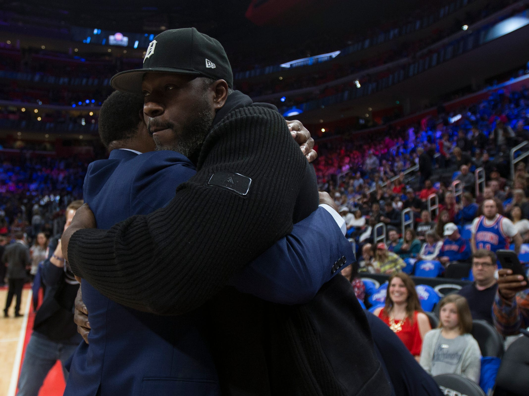 Isiah Thomas hugs Ben Wallace during the Pistons' ceremony for the 30th anniversary of the1989-90 back-to-back championships at the Little Caesars Arena in Detroit, Saturday, March 30, 2019.