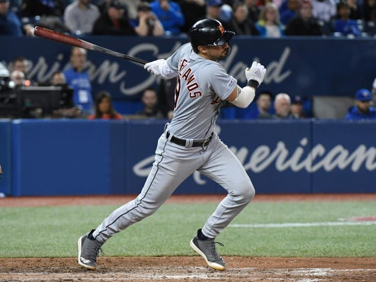 Nicholas Castellanos hits the go-ahead RBI single in the 11th inning Sunday.