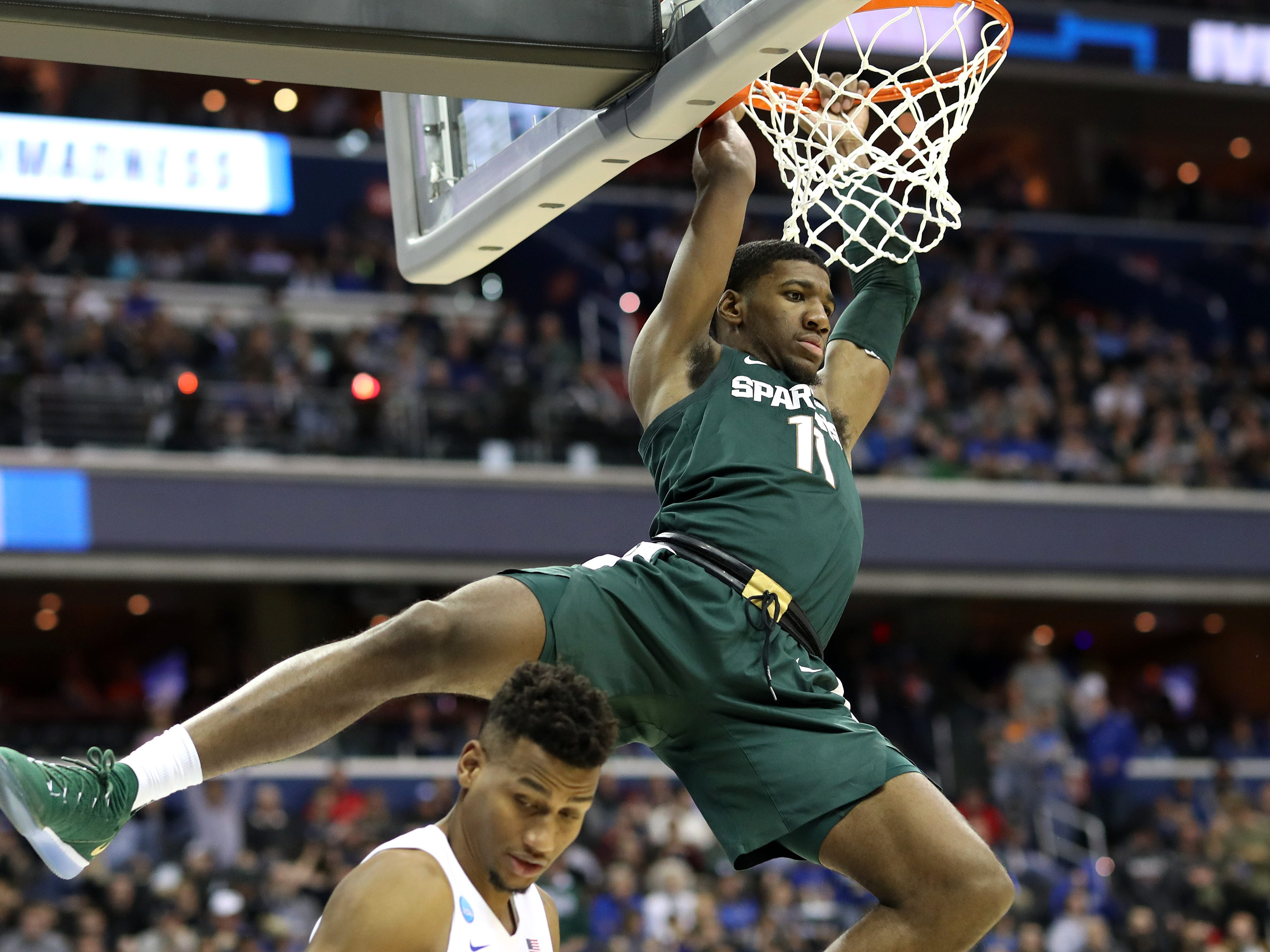 Michigan State's Aaron Henry dunks the ball against Duke during the second half in the NCAA tournament East Region final on Sunday, March 31, 2019, in Washington.