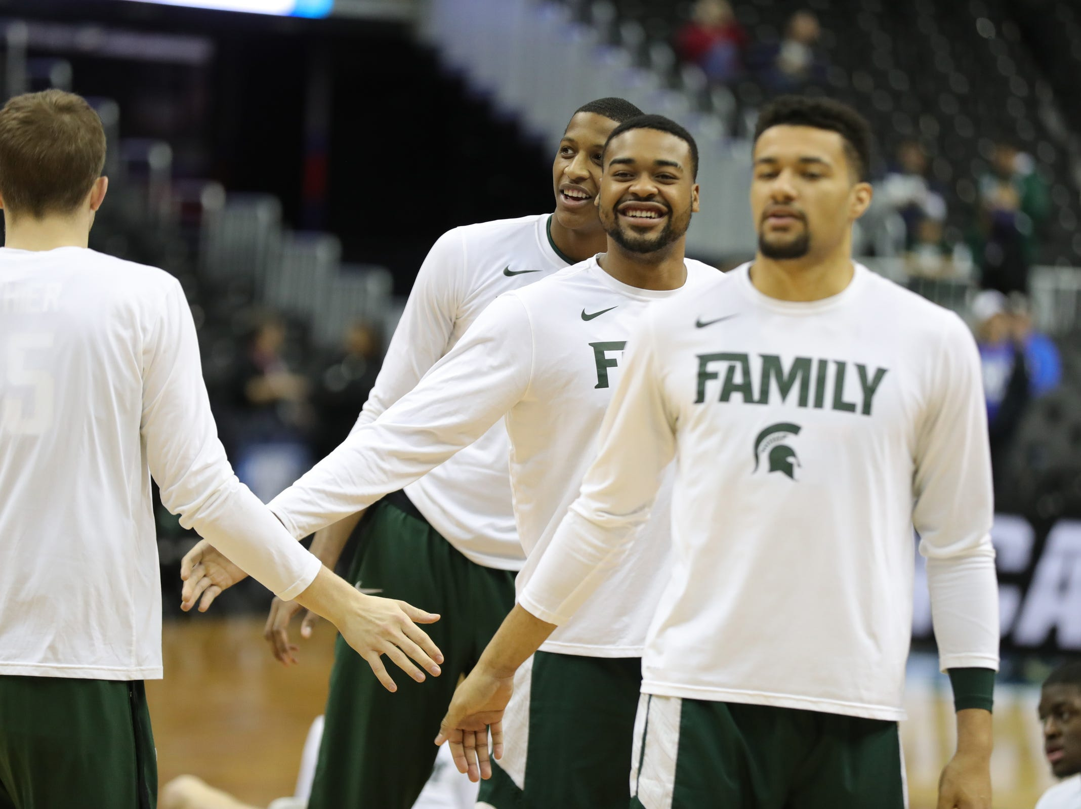 MSU players Kenny Goins, Nick Ward and Marcus Bingham Jr. warm up before East Region final against Duke on Sunday, March 31, 2019, in Washington.