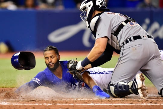 Toronto Blue Jays shortstop Richard Urena is tagged out at home plate by Detroit Tigers catcher Grayson Greiner on a run-saving play by Jordy Mercer in the 10th inning.