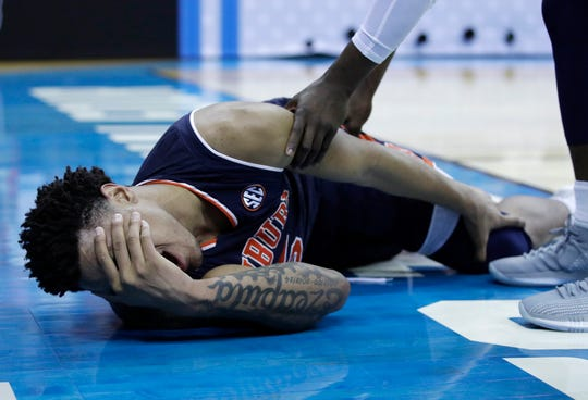 Auburn's Chuma Okeke yells out in pain after being injured during the second half of Friday's game.