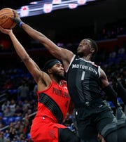 Detroit Pistons guard Reggie Jackson (1) blocks a layup attempt by Portland Trail Blazers forward Maurice Harkless (4) during the first half Saturday. Jackson finished with 28 points in Detroit's 99-90 victory.