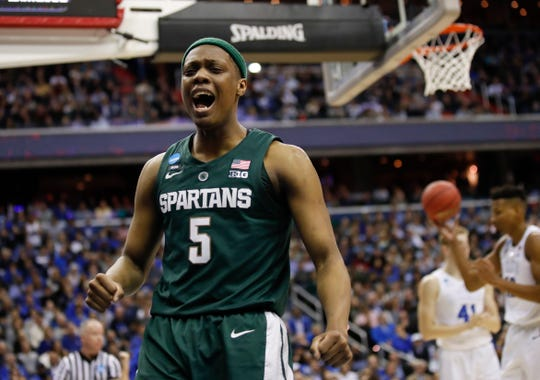 Michigan State guard Cassius Winston (5) reacts to scoring on Duke during the first half of an NCAA men's East Regional final college basketball game in Washington, Sunday, March 31, 2019. (AP Photo/Alex Brandon)