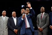 Former Detroit Pistons Isiah Thomas and members of the 1989-90 Championship team stand at mid-court during a ceremony honoring the team during halftime.