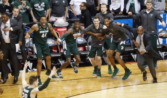 Michigan State players begin to celebrate their win over Duke.