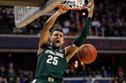 Michigan State forward Kenny Goins (25) scores against Duke during the first half.
