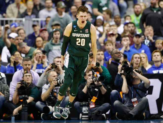 Michigan State guard Matt McQuaid makes a bucket during the first half.