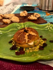 Erin McClaine's cinnamon bagel with boozy cherry cream cheese won the amateur category of the Let Them Eat Cake baking competition.