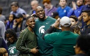 Michigan State alum Magic Johnson spoke to Spartans players before Sunday's NCAA East Region final against Duke.