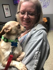 Foster care provider Vicki Surma holds one of the rescued dogs