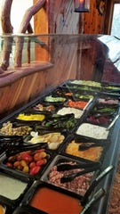 Enhance your meal at Carolyn's with a trip through the well-stocked salad bar.