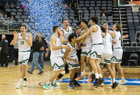 Northwest Missouri State Bearcats celebrate their NCAA Division II Men's Basketball National Championship victory over the Point Loma Sea Lions at Ford Center in Evansville, Ind., Saturday, March 30, 2019.  The Northwest Missouri State Bearcats defeated the Point Loma Sea Lions, 64-58.