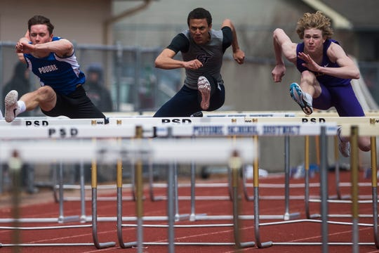 Poudre High school's Garrett Nelson, left, Cherokee Trail's Ian Gray, center, and Fort Collins' Jack Sheesley, right, compete in the boys 110-meter hurdles during the Altitude Running Invitational on March 30, 2019, at French Field. Athletes from all of Fort Collins' high schools' track and field teams will compete in the annual City Meet at 2 p.m. Tuesday at French Field.