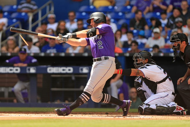 Colorado Rockies first baseman Mark Reynolds connects for a base hit during Saturday's game at Miami. The Rockies continue their season-opening road trip with games Monday through Wednesday at Tampa Bay before facing the Los Angeles Dodgers in their home opener Friday at Coors Field.