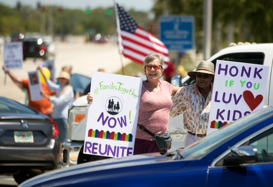 Kay Flatten and Lewis Robinson rally on Sunday to bring attention to the issue of migrant children separation and detention in America. More than 50 people who attended the rally at the intersection of Daniels Parkway and U.S. 41 in south Fort Myers.
