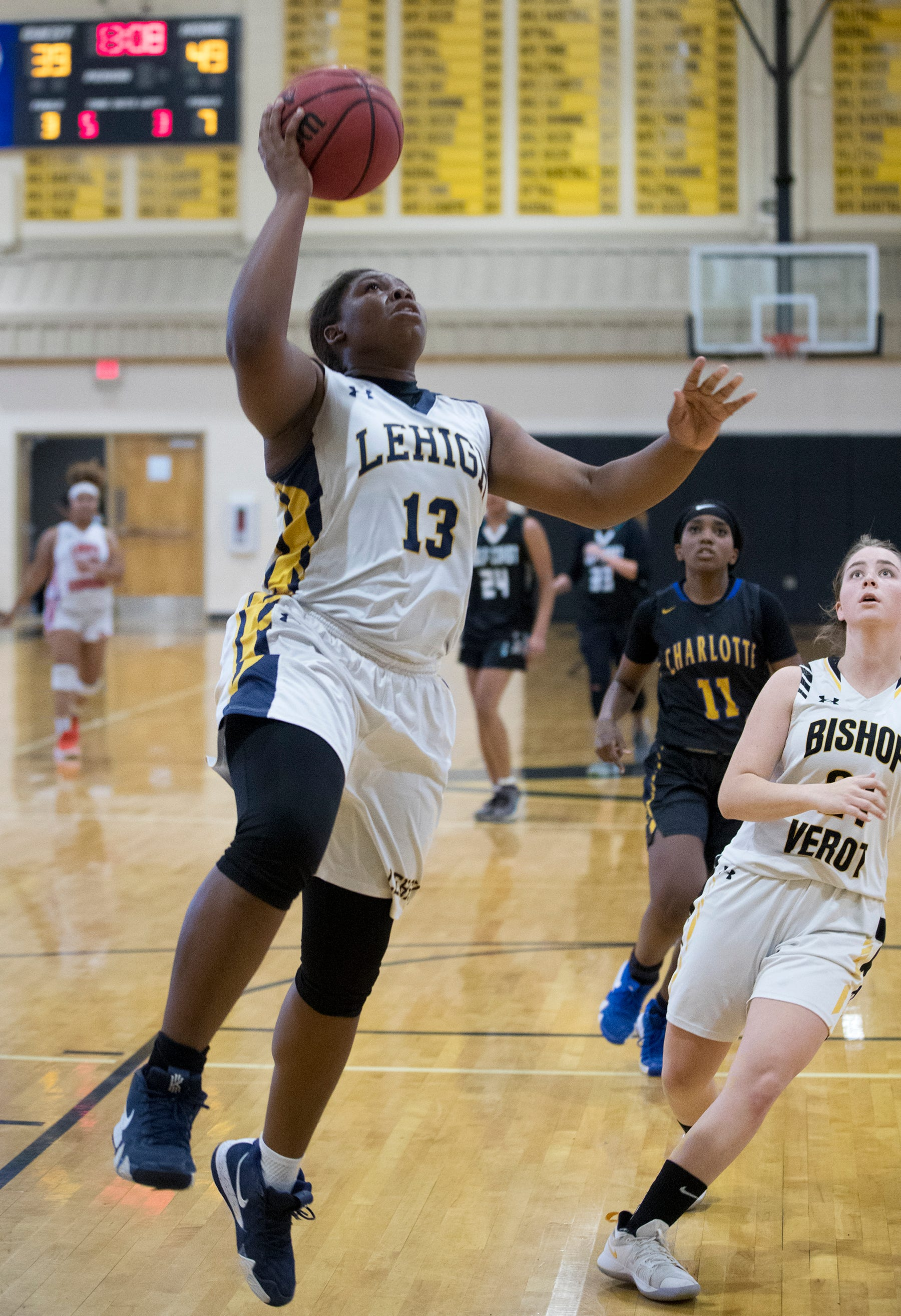 Lehigh High School's Aliesha Curry scores on Sunday during the SFABC Girls All-Star Basketball Game at Bishop Verot in Fort Myers.