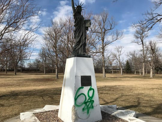 The replica Statue of Liberty in Gibson Park was spray-painted over the weekend.