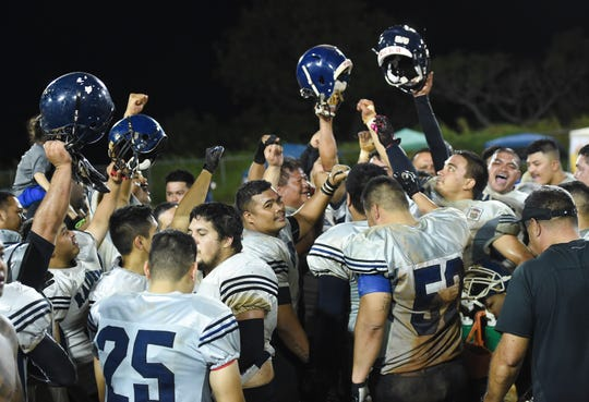 The Raiders celebrate their win over two-time defending champion Guahan Eagles in the Budweiser Guahan Varsity Football League championship game at Hal's Angels Field in Dededo, March 30, 2019.