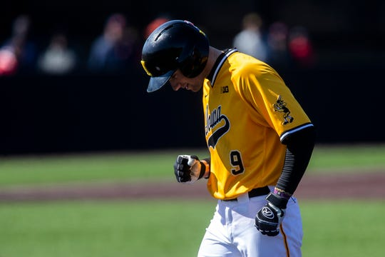 Iowa outfielder Ben Norman (9) celebrates after getting on base during a NCAA Big Ten Conference baseball game on Sunday, March 31, 2019, at Duane Banks Field in Iowa City, Iowa.