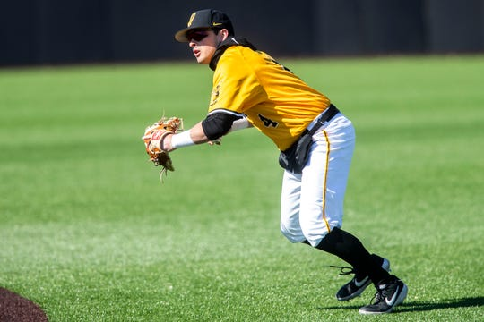 Iowa infielder Mitchell Boe (4) fields a ball during a NCAA Big Ten Conference baseball game on Sunday, March 31, 2019, at Duane Banks Field in Iowa City, Iowa.