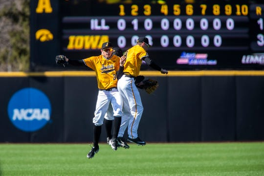 Iowa's Trenton Wallace (38) Iowa outfielder Justin Jenkins (6) and Iowa outfielder Ben Norman (9) celebrate after a NCAA Big Ten Conference baseball game on Sunday, March 31, 2019, at Duane Banks Field in Iowa City, Iowa. The Hawkeyes defeated Illinois 3-1, sweeping the series.