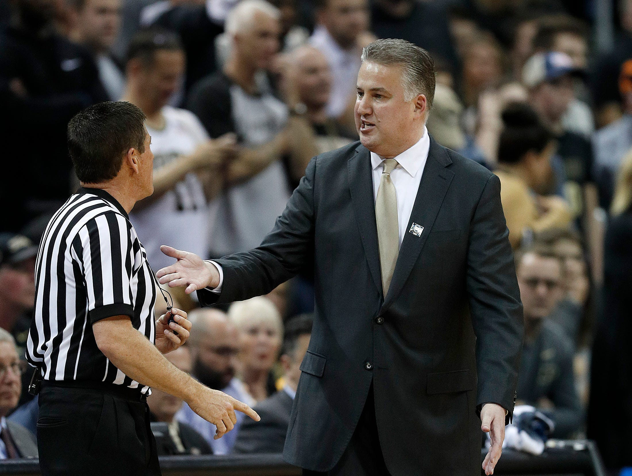 """Purdue Boilermakers head coach Matt Painter argues a call with an official in the first half of their NCAA Division I Basketball Championship """"Elite 8"""" basketball game at the KFC Yum! Center in Louisville, KY., on Saturday, Mar 30, 2019."""