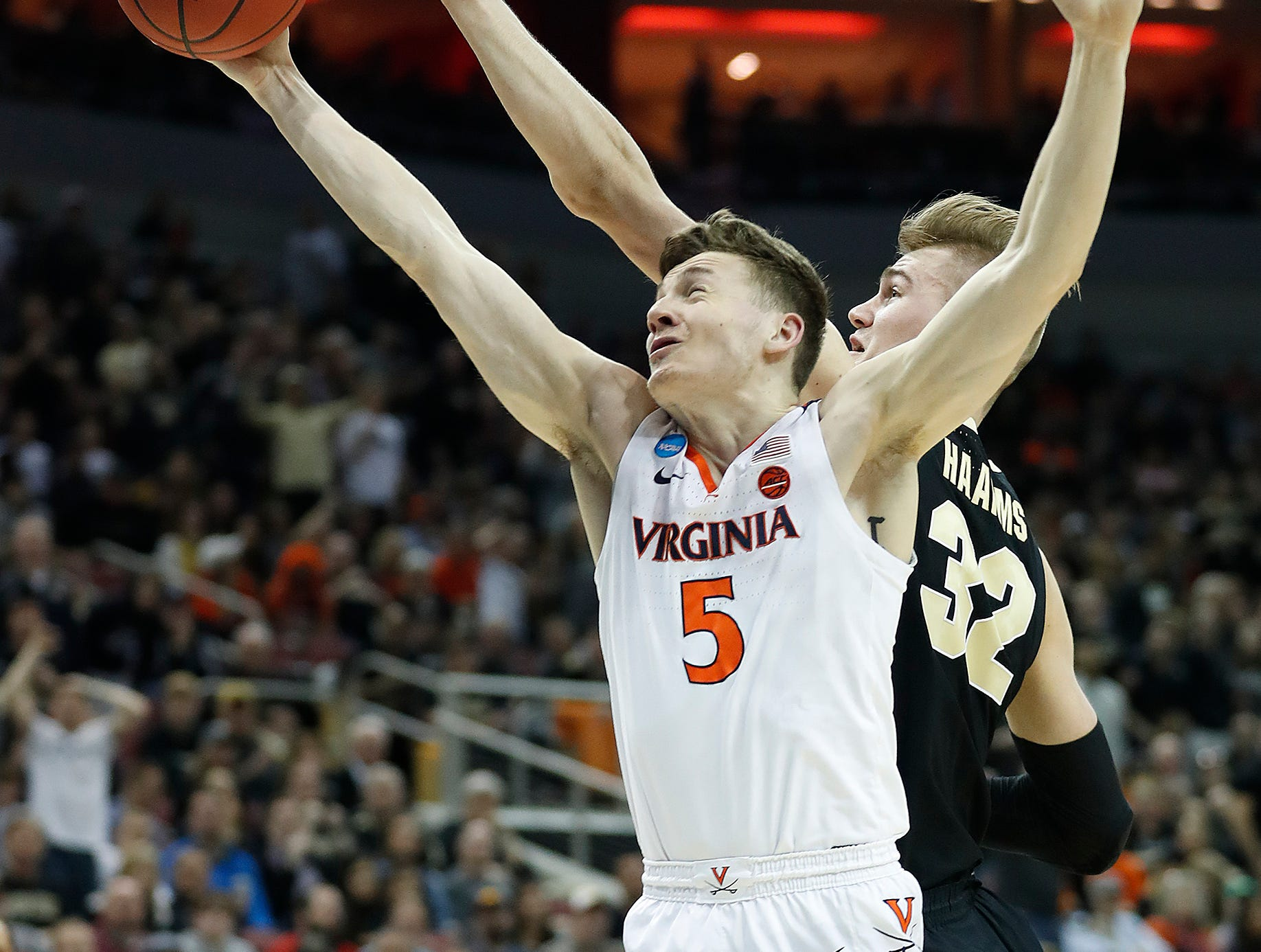 """Virginia Cavaliers guard Kyle Guy (5) and Purdue Boilermakers center Matt Haarms (32) fight for a rebound in the first half of their NCAA Division I Basketball Championship """"Elite 8"""" basketball game at the KFC Yum! Center in Louisville, KY., on Saturday, Mar 30, 2019."""