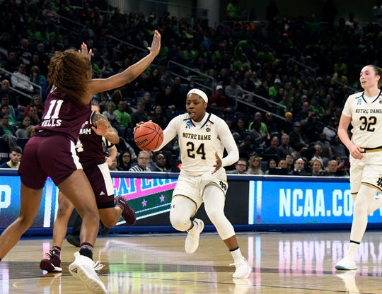 Mar 30, 2019; Chicago, IL, USA; Notre Dame Fighting Irish guard Arike Ogunbowale (24) brings the ball up the court against the Texas A&M Aggies during the second half in the semifinals of the Chicago regional in the women's 2019 NCAA Tournament at Wintrust Arena. Mandatory Credit: David Banks-USA TODAY Sports