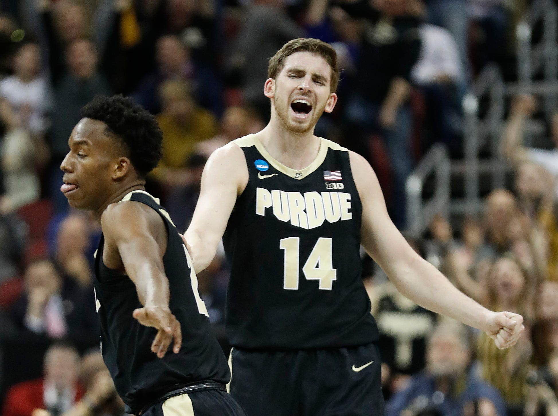 "Purdue Boilermakers guard Ryan Cline (14) celebrates with Eric Hunter Jr. (2) in the first half of their NCAA Division I Basketball Championship ""Elite 8"" basketball game at the KFC Yum! Center in Louisville, KY., on Saturday, Mar 30, 2019."