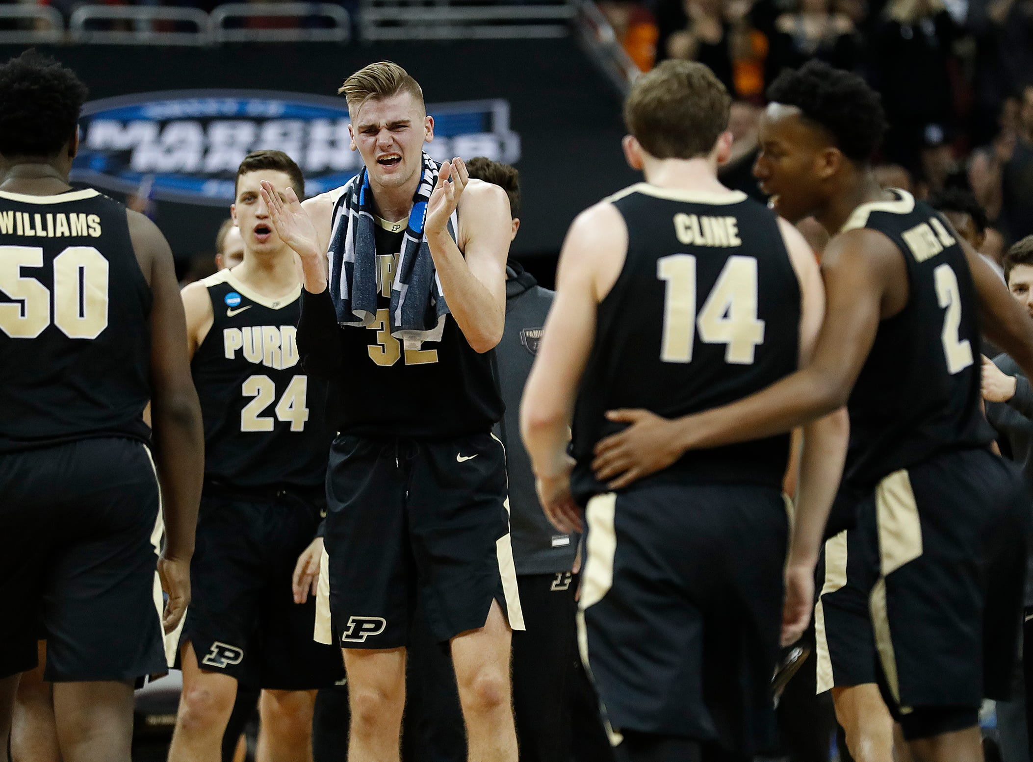 "Purdue Boilermakers center Matt Haarms (32) cheers on his team in the first half of their NCAA Division I Basketball Championship ""Elite 8"" basketball game at the KFC Yum! Center in Louisville, KY., on Saturday, Mar 30, 2019."