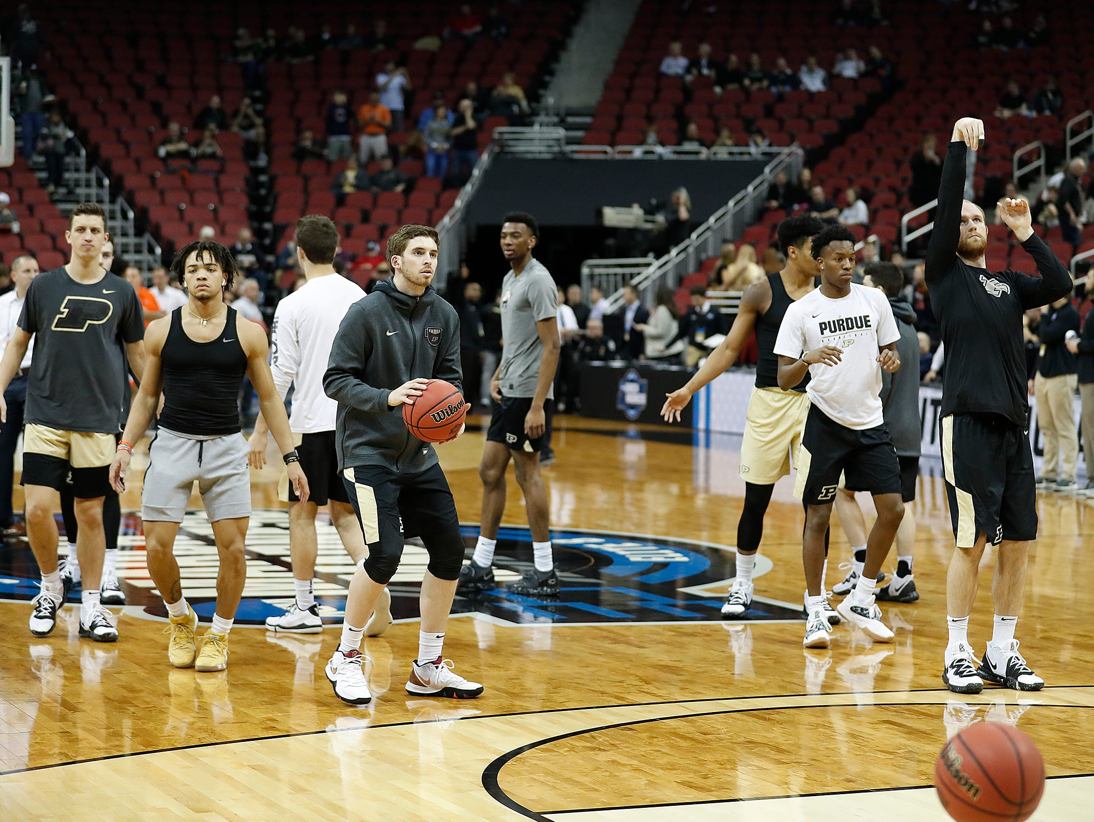 "Purdue Boilermakers warm up before the start of the NCAA Division I Basketball Championship ""Elite 8"" basketball game at the KFC Yum! Center in Louisville, KY., on Saturday, Mar 30, 2019."