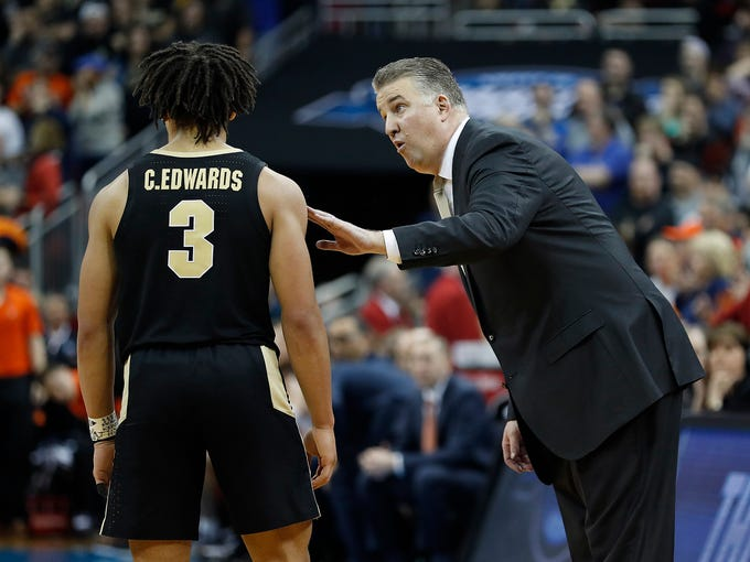 "Purdue Boilermakers head coach Matt Painter talks with guard Carsen Edwards (3) in the second half of their NCAA Division I Basketball Championship ""Elite 8"" basketball game at the KFC Yum! Center in Louisville, KY., on Saturday, Mar 30, 2019. The Virginia Cavaliers defeated the Purdue Boilermakers 80-75."