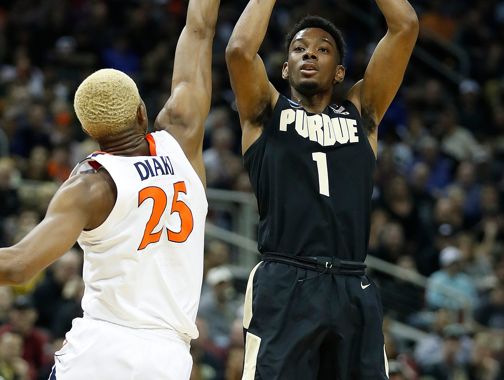 "Purdue Boilermakers forward Aaron Wheeler (1) shoots a three point basket over Virginia Cavaliers forward Mamadi Diakite (25) in the first half of their NCAA Division I Basketball Championship ""Elite 8"" basketball game at the KFC Yum! Center in Louisville, KY., on Saturday, Mar 30, 2019."