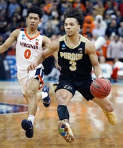 "Purdue Boilermakers guard Carsen Edwards (3) drives by Virginia Cavaliers guard Kihei Clark (0) in the second half of their NCAA Division I Basketball Championship ""Elite 8"" basketball game at the KFC Yum! Center in Louisville, KY., on Saturday, Mar 30, 2019. The Virginia Cavaliers defeated the Purdue Boilermakers 80-75."