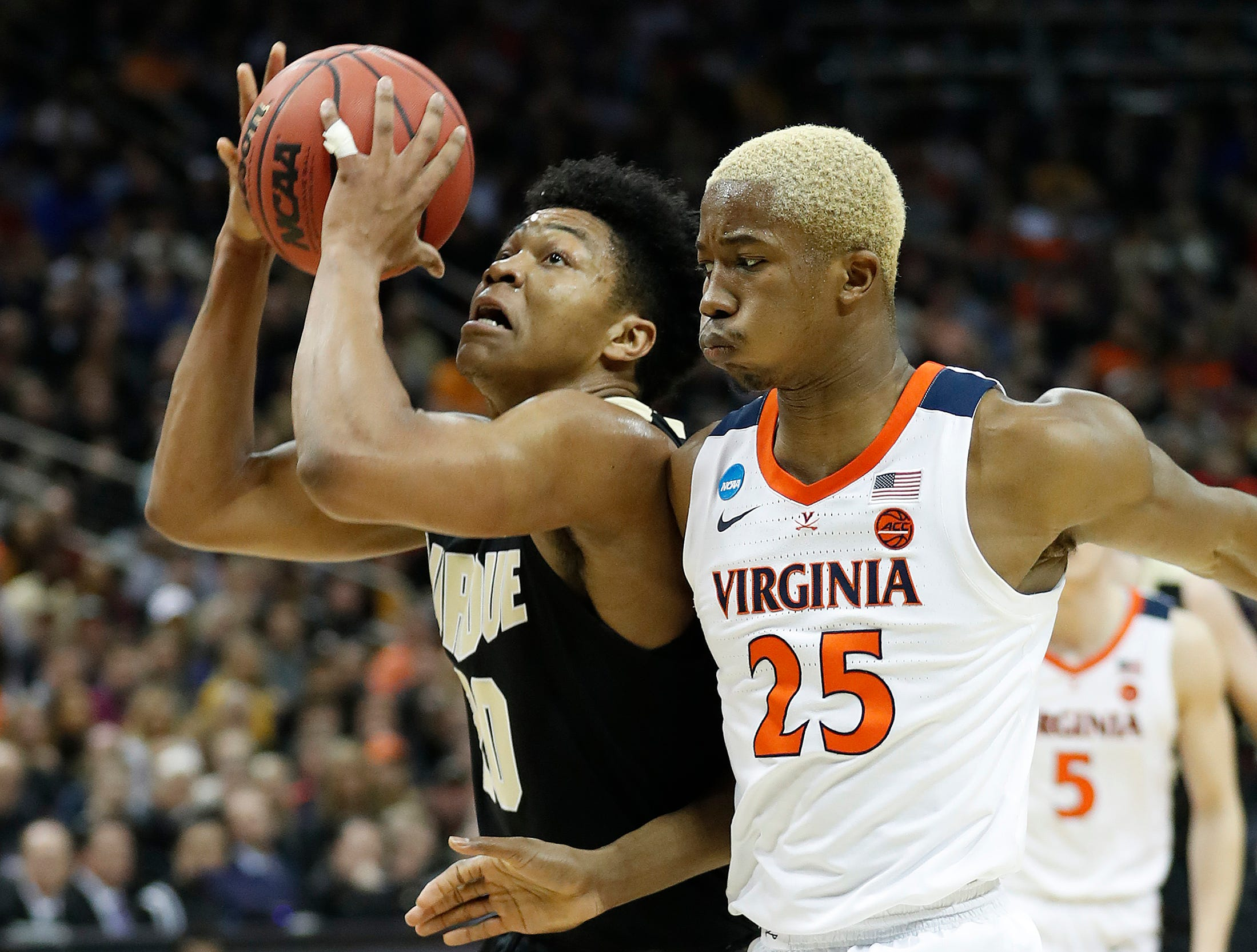 "Purdue Boilermakers guard Nojel Eastern (20) drives on Virginia Cavaliers forward Mamadi Diakite (25) in the first half of their NCAA Division I Basketball Championship ""Elite 8"" basketball game at the KFC Yum! Center in Louisville, KY., on Saturday, Mar 30, 2019."
