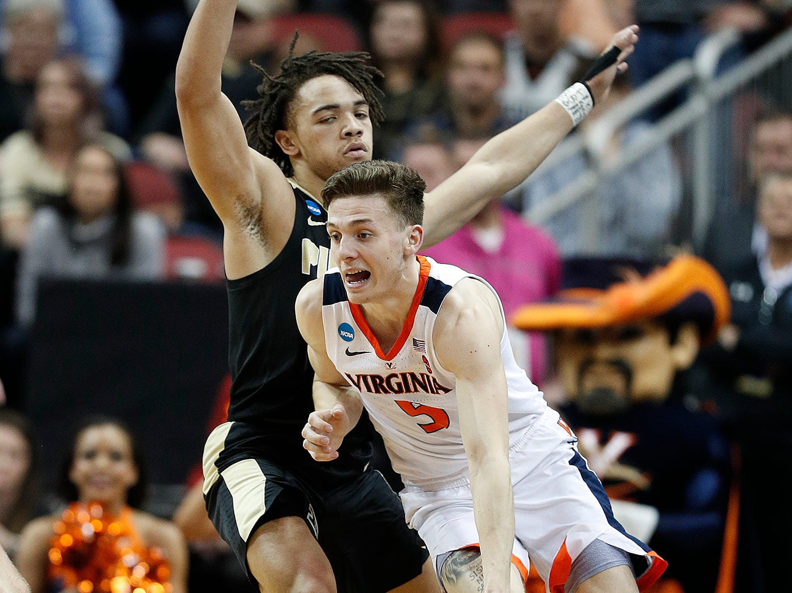 "Virginia Cavaliers guard Kyle Guy (5) drives around Purdue Boilermakers guard Carsen Edwards (3) in the second half of their NCAA Division I Basketball Championship ""Elite 8"" basketball game at the KFC Yum! Center in Louisville, KY., on Saturday, Mar 30, 2019. The Virginia Cavaliers defeated the Purdue Boilermakers 80-75."