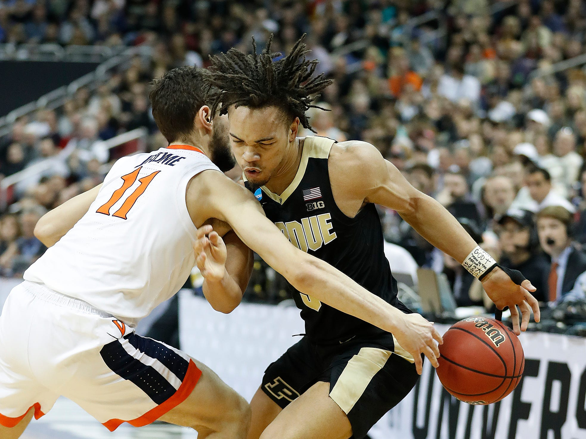"Purdue Boilermakers guard Carsen Edwards (3) is fouled by Virginia Cavaliers guard Ty Jerome (11) in the first half of their NCAA Division I Basketball Championship ""Elite 8"" basketball game at the KFC Yum! Center in Louisville, KY., on Saturday, Mar 30, 2019."