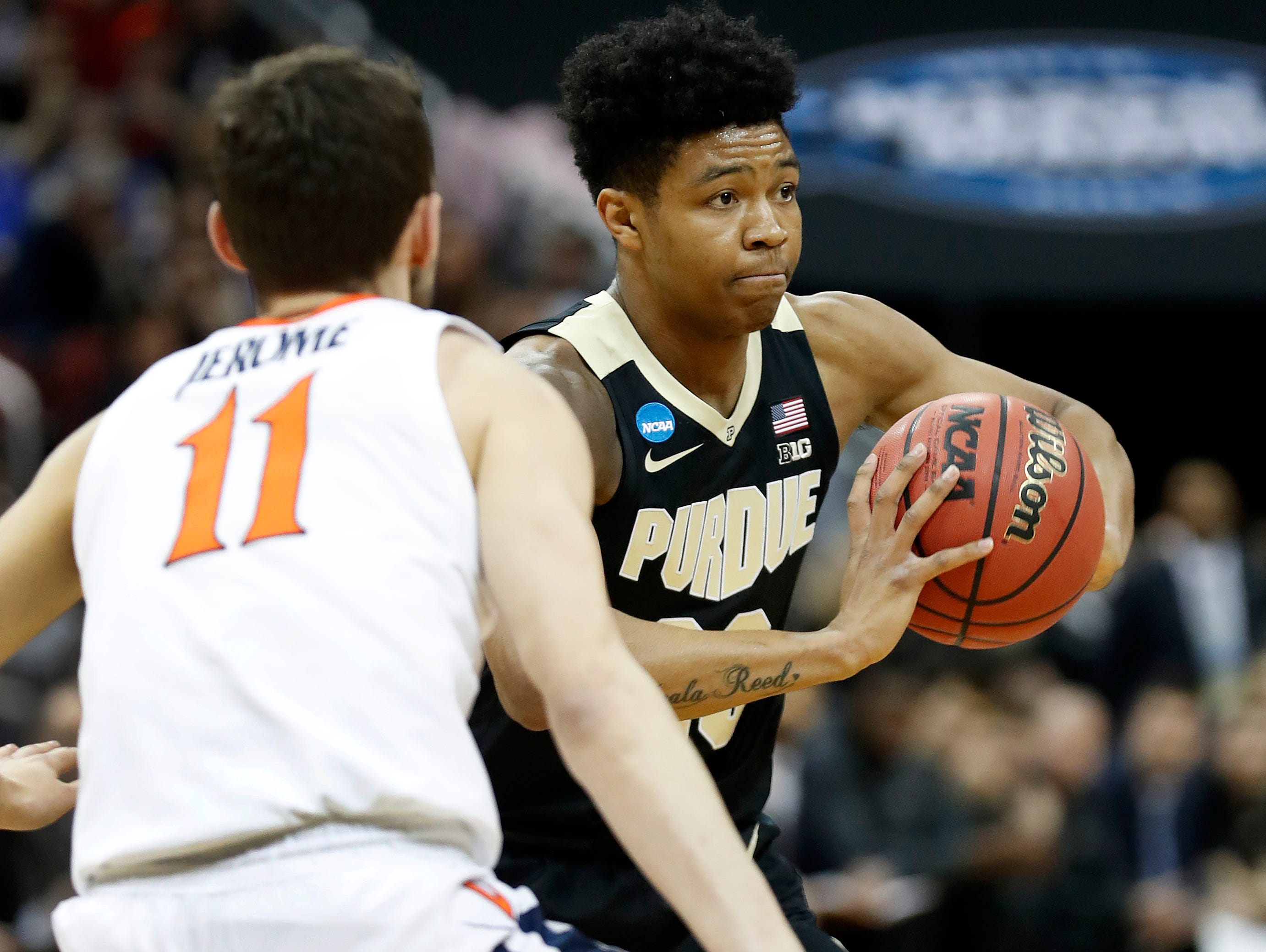 "Purdue Boilermakers guard Nojel Eastern (20) passes the ball by Virginia Cavaliers guard Ty Jerome (11) in the first half of their NCAA Division I Basketball Championship ""Elite 8"" basketball game at the KFC Yum! Center in Louisville, KY., on Saturday, Mar 30, 2019."