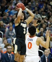 Purdue Boilermakers guard Carsen Edwards (3) shoots a three point basket over Virginia Cavaliers guard Kihei Clark (0).
