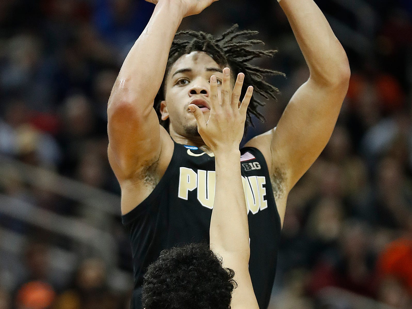 "Purdue Boilermakers guard Carsen Edwards (3) shoots a three point basket over Virginia Cavaliers guard Kihei Clark (0) in the first half of their NCAA Division I Basketball Championship ""Elite 8"" basketball game at the KFC Yum! Center in Louisville, KY., on Saturday, Mar 30, 2019."