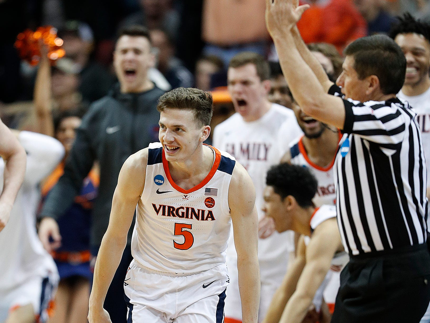 "Virginia Cavaliers guard Kyle Guy (5) celebrates hitting the three point basket in the second half of their NCAA Division I Basketball Championship ""Elite 8"" basketball game at the KFC Yum! Center in Louisville, KY., on Saturday, Mar 30, 2019. The Virginia Cavaliers defeated the Purdue Boilermakers 80-75."