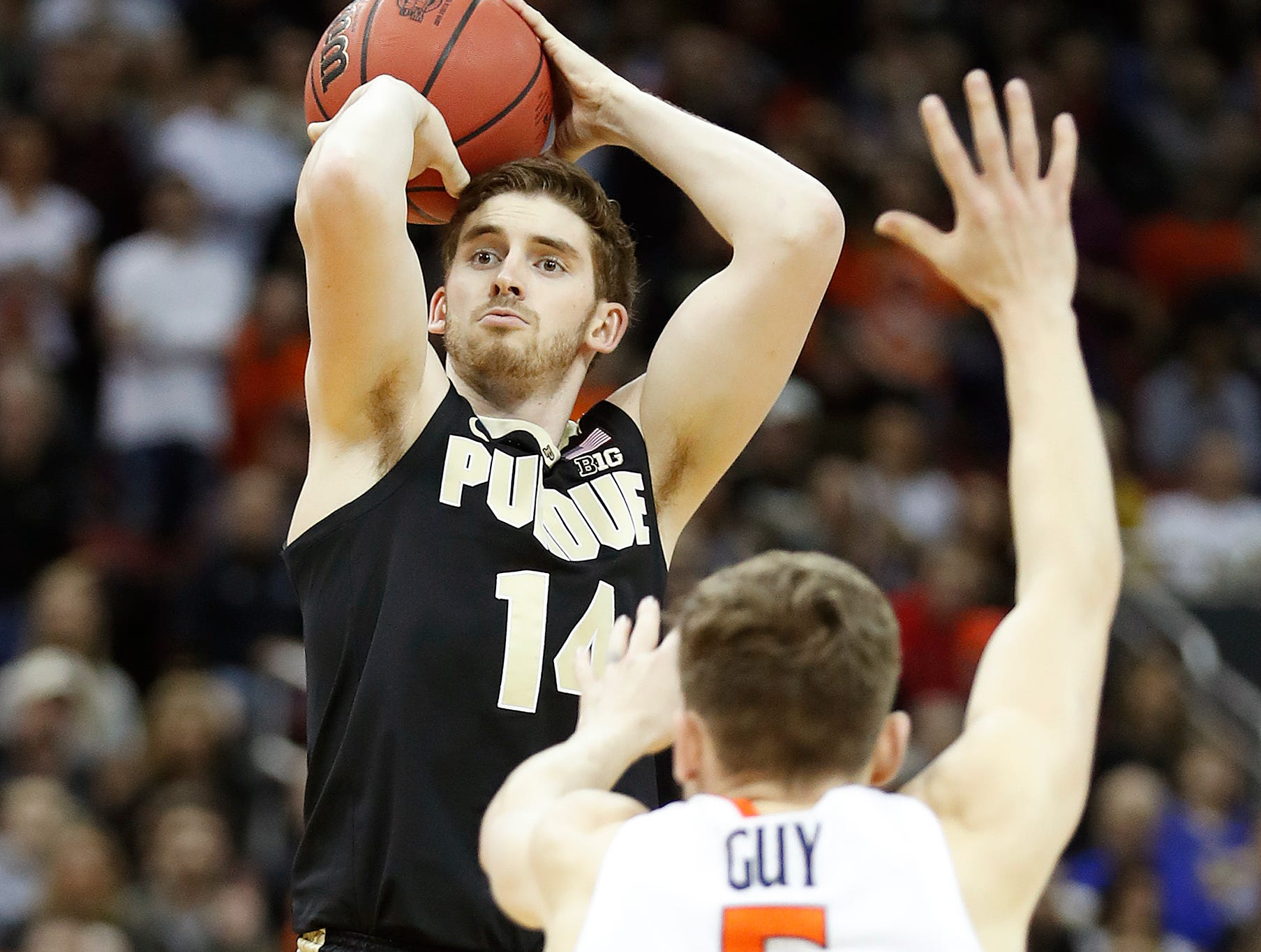 "Purdue Boilermakers guard Ryan Cline (14) shoots a three point basket over Virginia Cavaliers guard Kyle Guy (5) in the first half of their NCAA Division I Basketball Championship ""Elite 8"" basketball game at the KFC Yum! Center in Louisville, KY., on Saturday, Mar 30, 2019."
