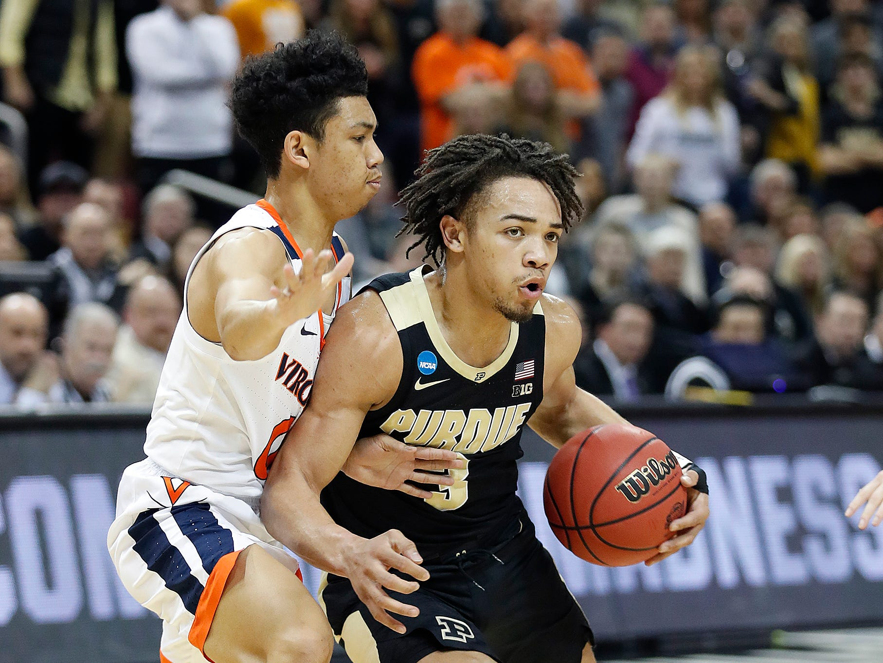 "Purdue Boilermakers guard Carsen Edwards (3) drives around Virginia Cavaliers guard Kihei Clark (0) in the first half of their NCAA Division I Basketball Championship ""Elite 8"" basketball game at the KFC Yum! Center in Louisville, KY., on Saturday, Mar 30, 2019."