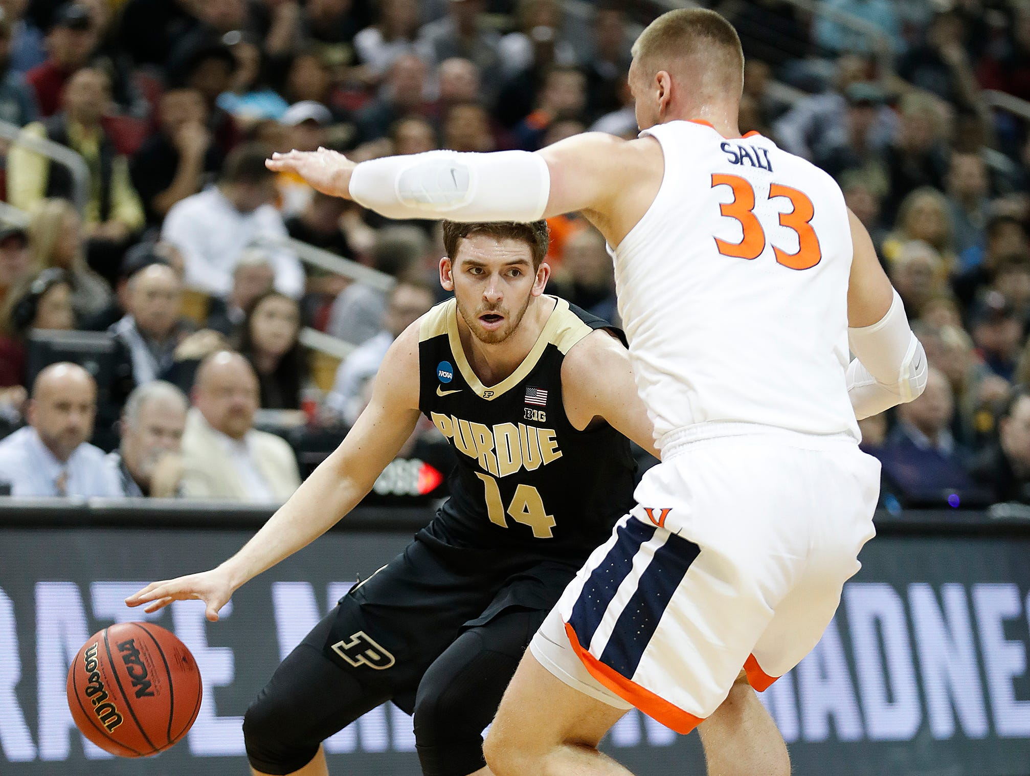 "Purdue Boilermakers guard Ryan Cline (14) looks to pass around Virginia Cavaliers center Jack Salt (33) in the first half of their NCAA Division I Basketball Championship ""Elite 8"" basketball game at the KFC Yum! Center in Louisville, KY., on Saturday, Mar 30, 2019."