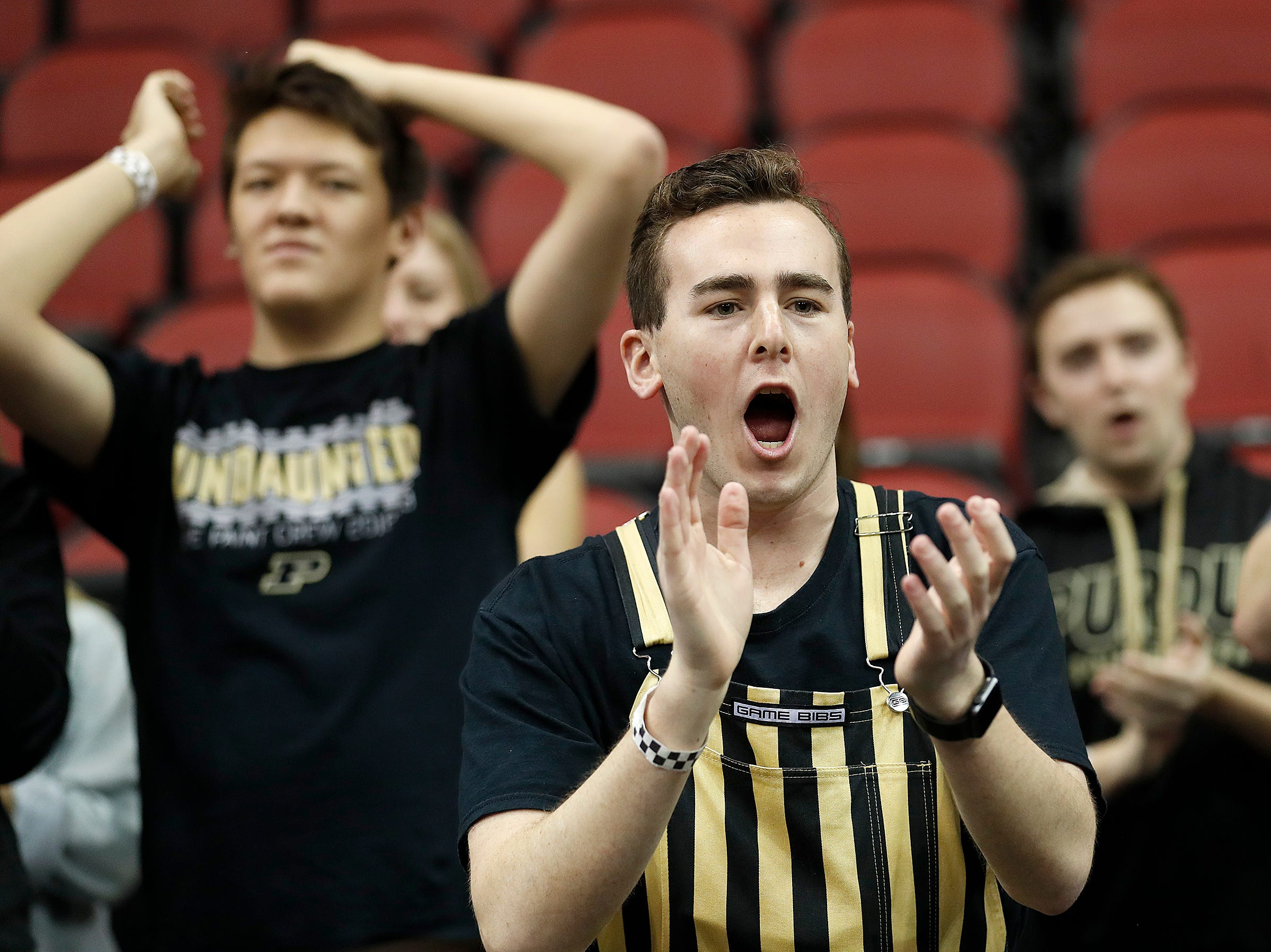 "Purdue Boilermakers fans cheer on their team as they warm up for the NCAA Division I Basketball Championship ""Elite 8"" basketball game at the KFC Yum! Center in Louisville, KY., on Saturday, Mar 30, 2019."