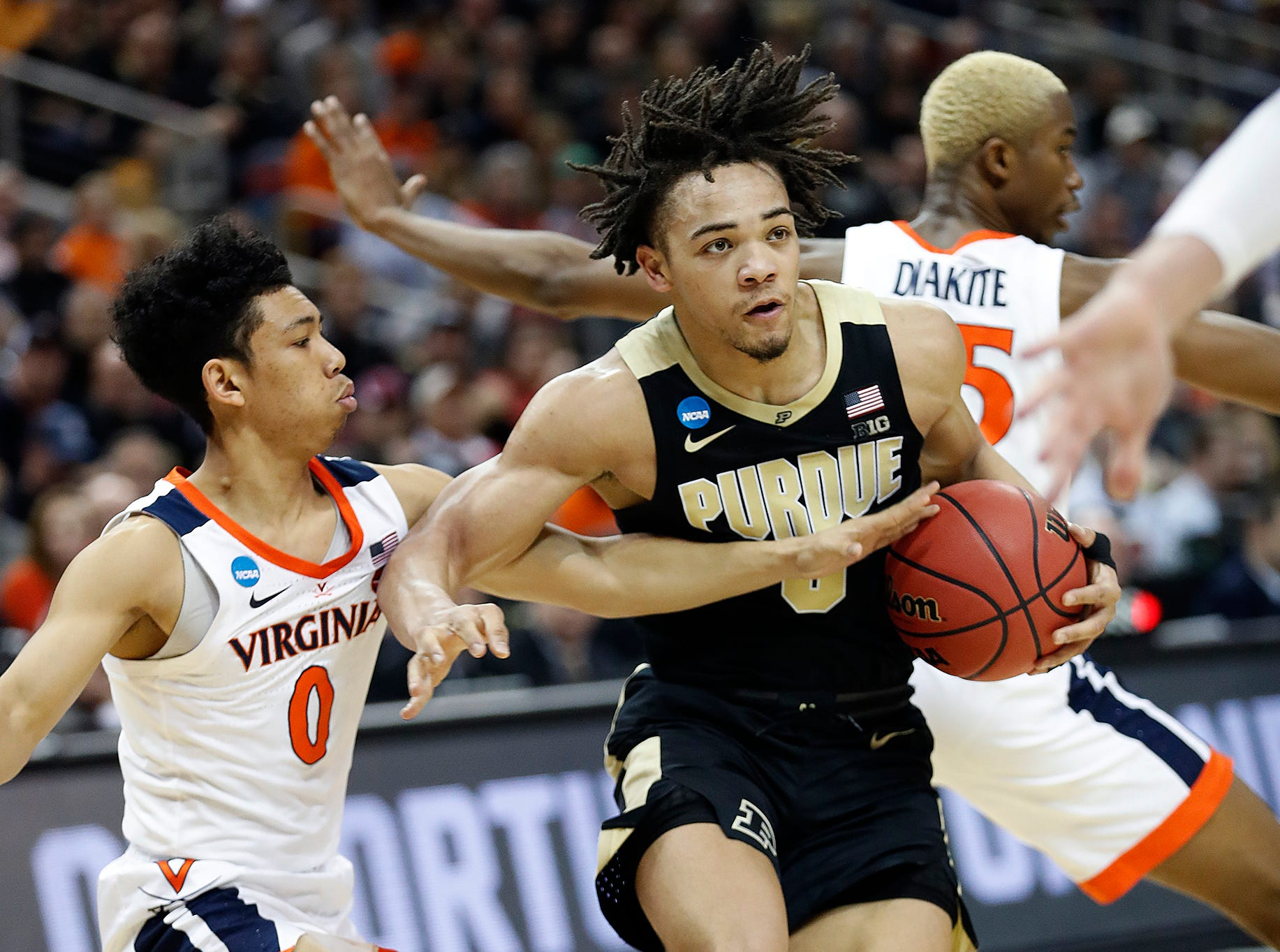 "Purdue Boilermakers guard Carsen Edwards (3) drives on Virginia Cavaliers guard Kihei Clark (0) in the first half of their NCAA Division I Basketball Championship ""Elite 8"" basketball game at the KFC Yum! Center in Louisville, KY., on Saturday, Mar 30, 2019."
