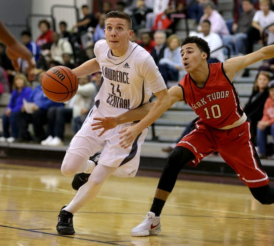 Lawrence CentralÕs Kyle Guy (24) drives around Park TudorÕs Kobe Webster (10) in the second half of their game Wednesday, Jan 6, 2016, evening at Lawrence Central High School.