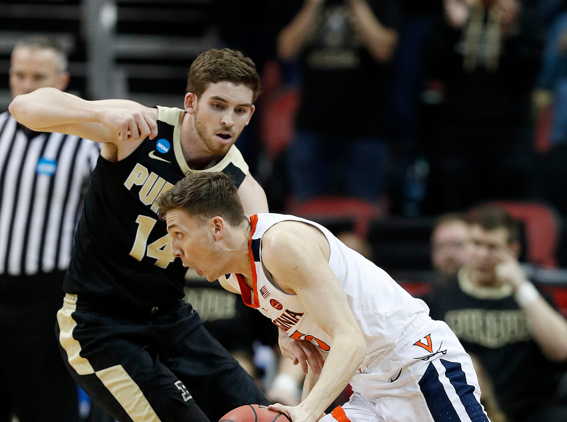 "Virginia Cavaliers guard Kyle Guy (5) driveson Purdue Boilermakers guard Ryan Cline (14) in the first half of their NCAA Division I Basketball Championship ""Elite 8"" basketball game at the KFC Yum! Center in Louisville, KY., on Saturday, Mar 30, 2019."