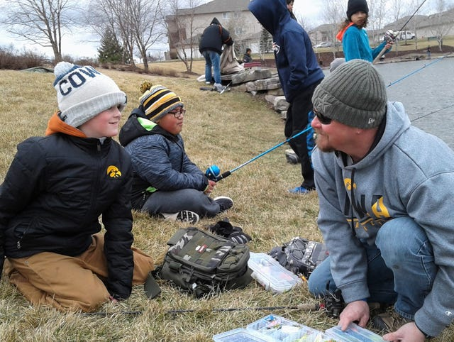 North Liberty pond attracts trout fisherman from around Iowa City